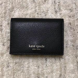 KATE SPADE New York wallet.